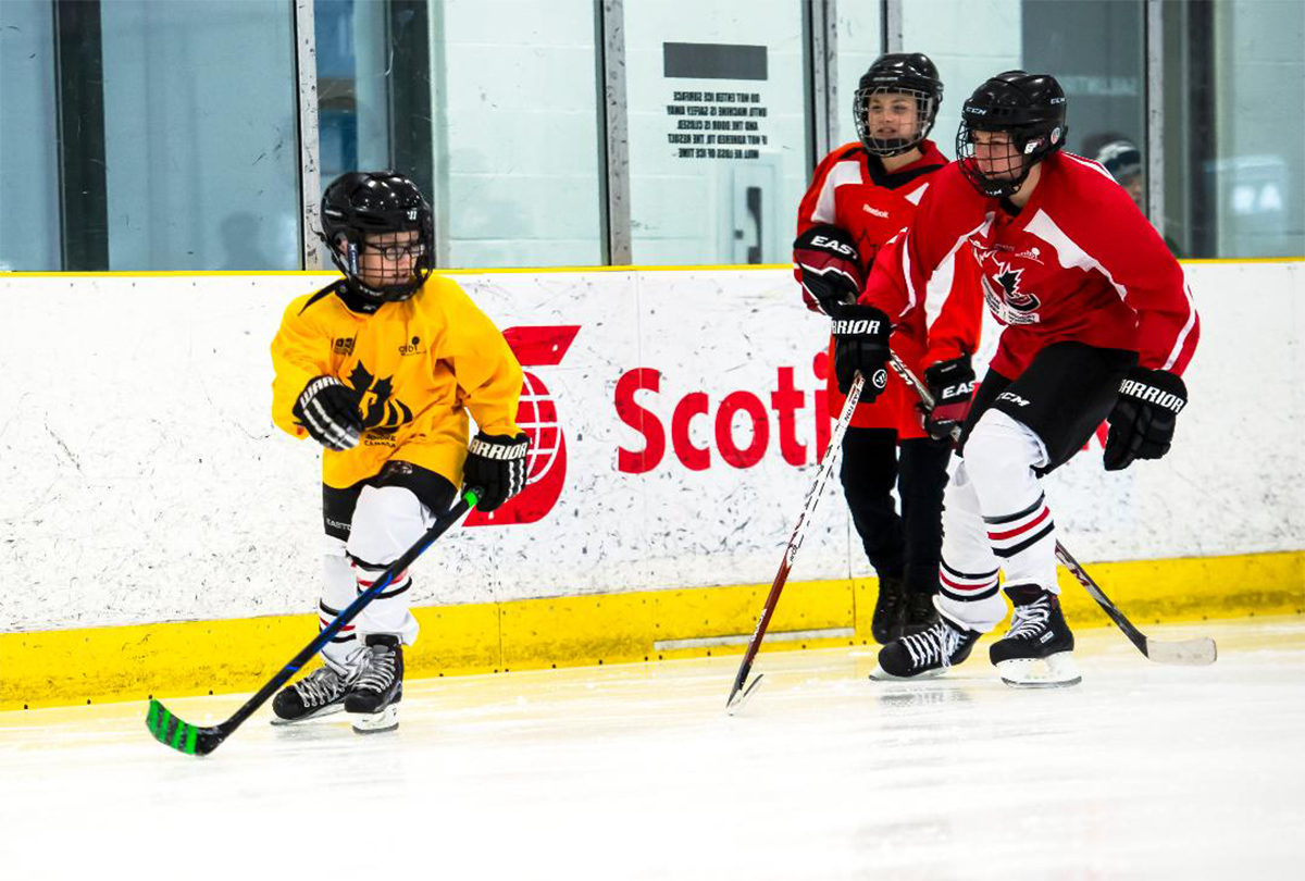 Two blind hockey players competing for the puck