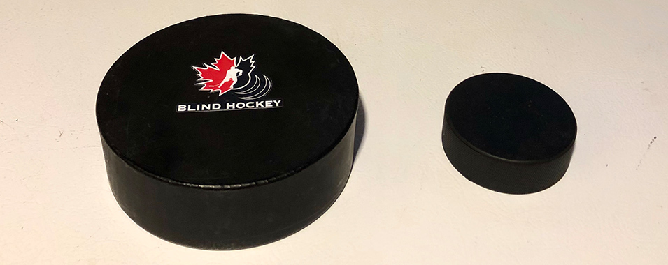 Adapted blind ice hockey puck